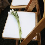 In honor of a passed loved one, we kept this chair empty and laid flowers.